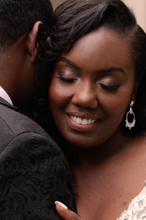 bride hugging groom shoulder