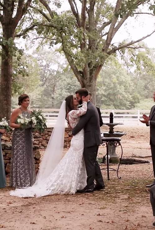 bride and groom ceremony kiss at serenata farms