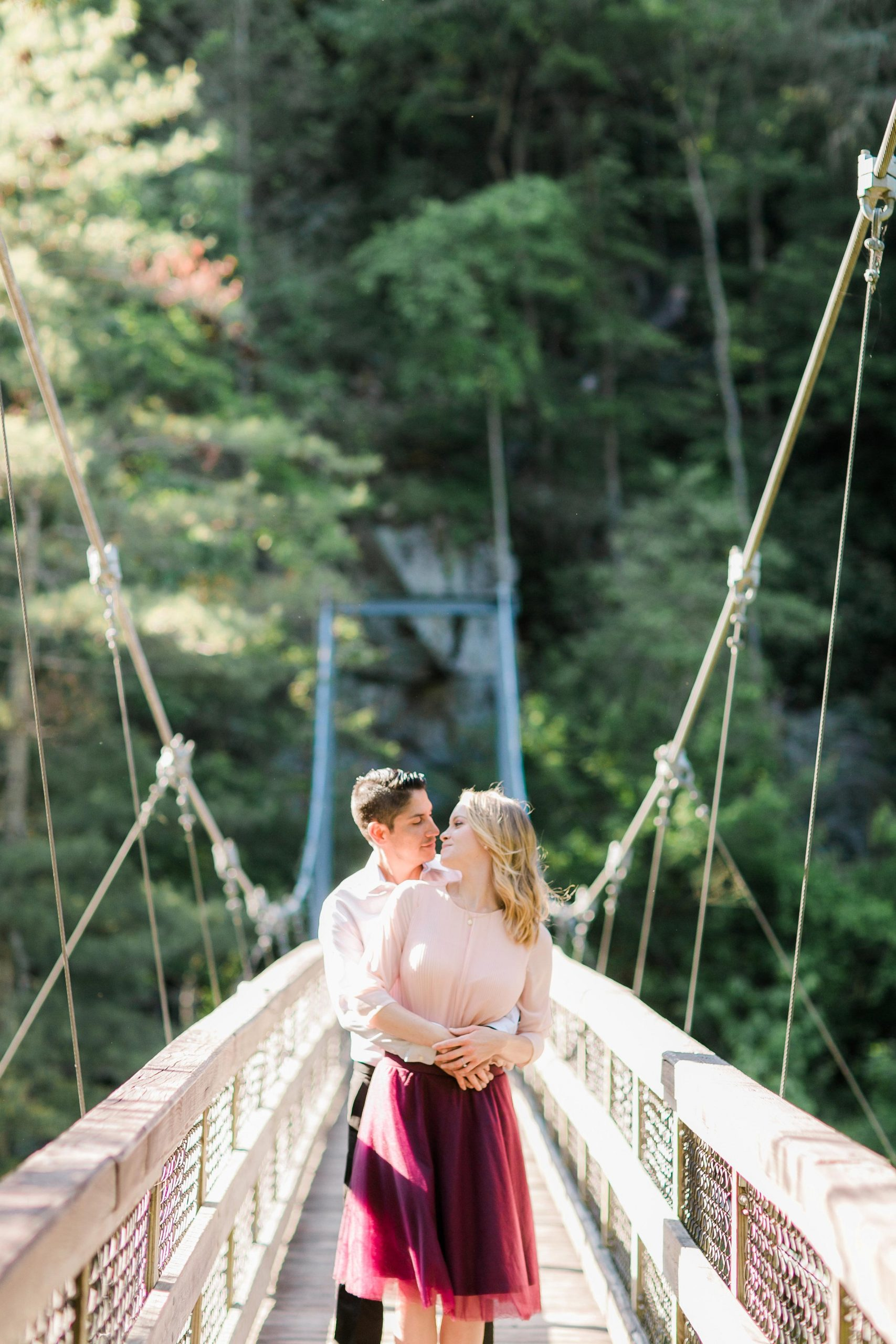 engagement shoot with bride and groom on bridge