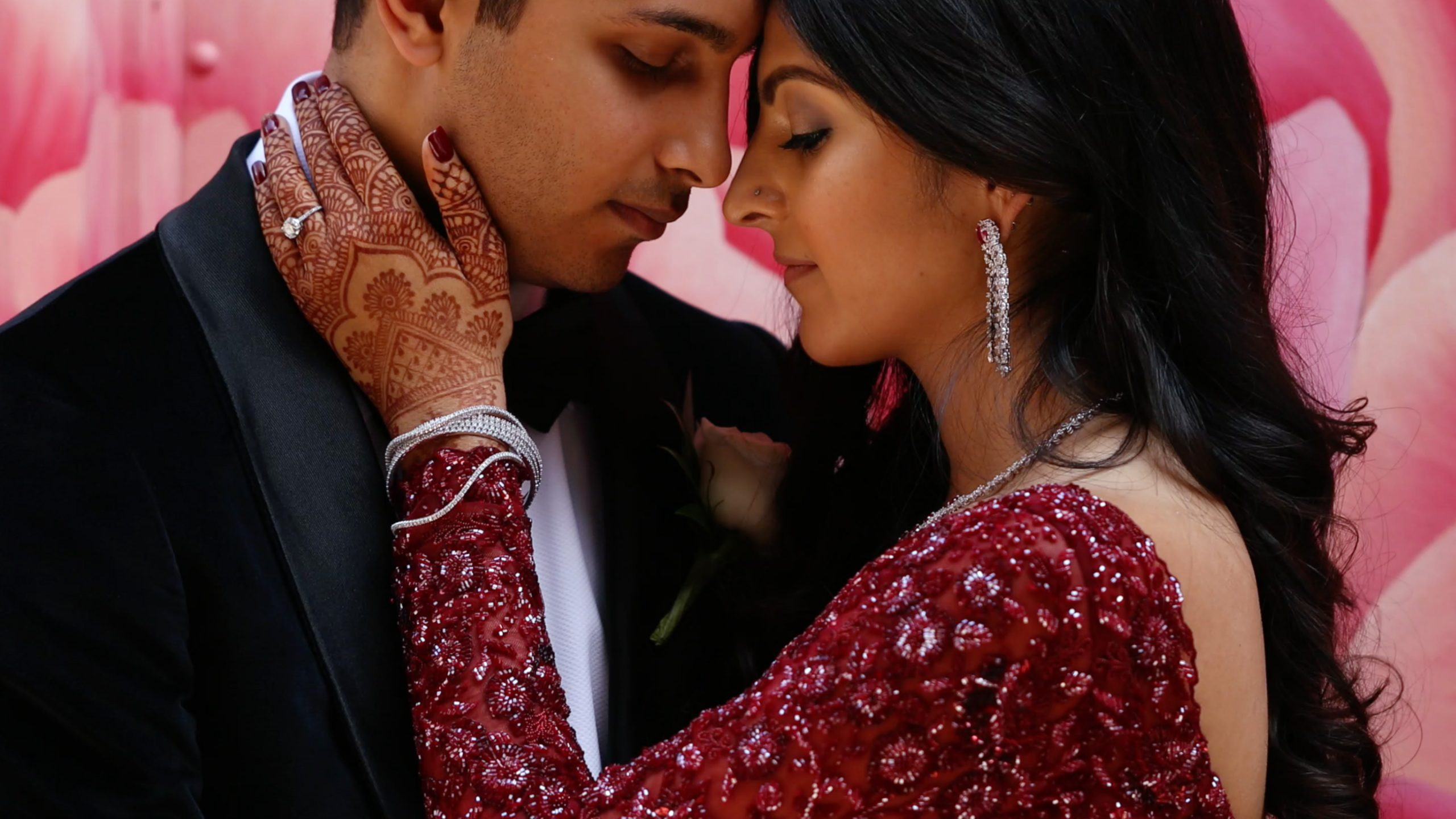 indian bride and groom romantic shot with henna hand and ring