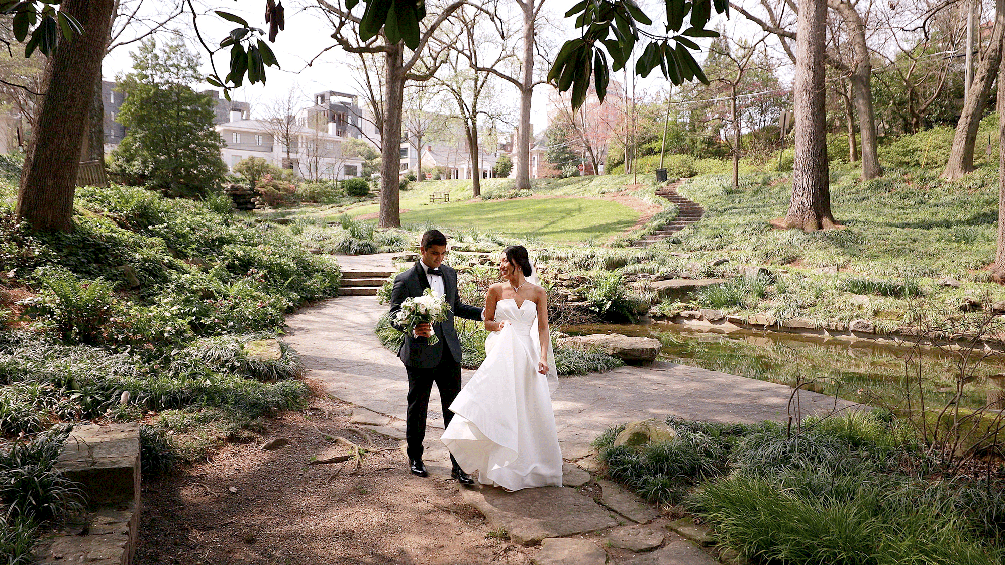 bride and groom walking in winn park atlanta