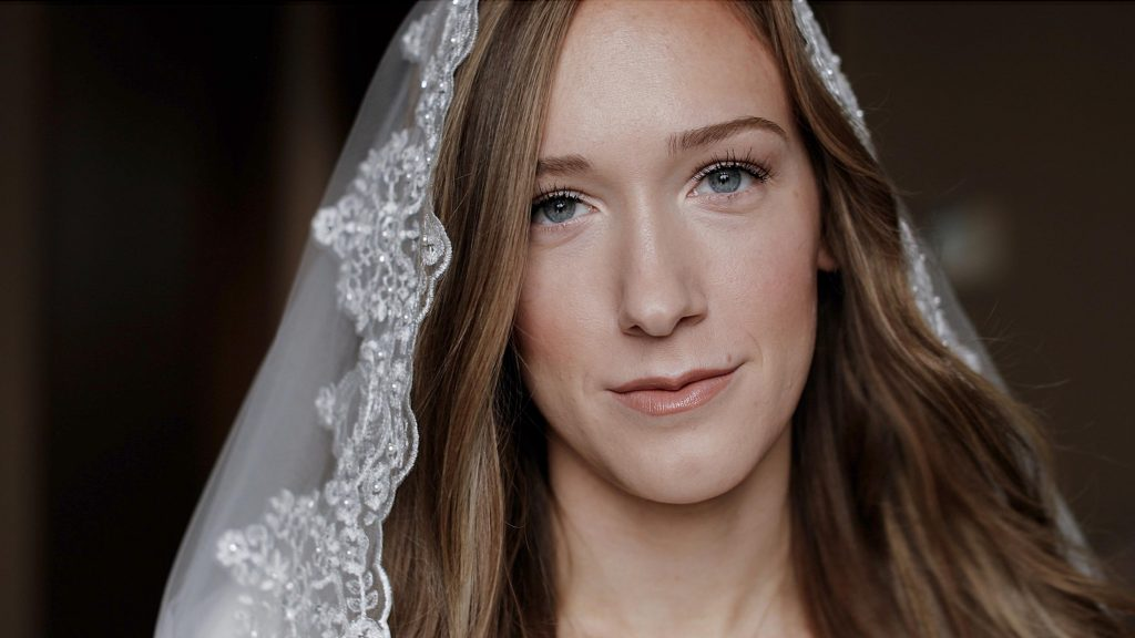 girl wearing catholic veil